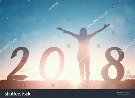 what religion is the new year silhouette 2018 raised stock photo