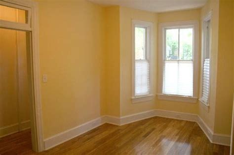 butter yellow walls and contrasting base boards in yelp