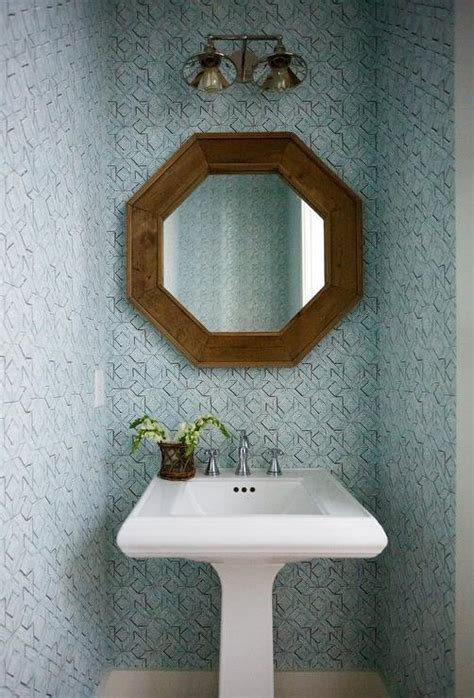 wood quatrefoil mirror over pedestal sink transitional