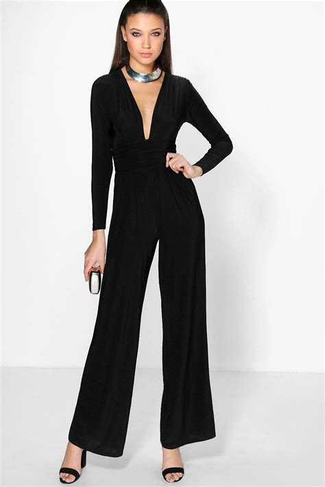 Jumpsuit Jumbo Jumpsuit Bigsize graham flaunts jaw dropping cleavage in dramatically plunging jumpsuit and a lighter