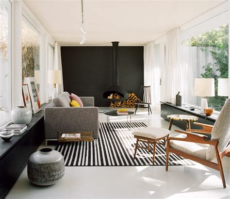 black accent wall in living room a hanging fireplace and black accent wall stand out in this modern living room contemporist