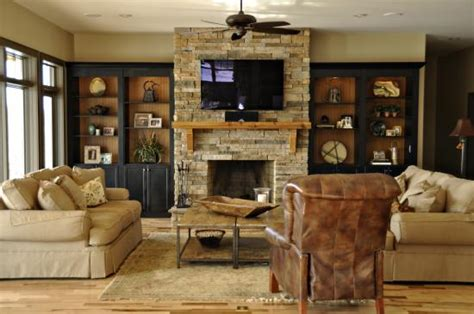 black built ins bookcases around stone fireplace