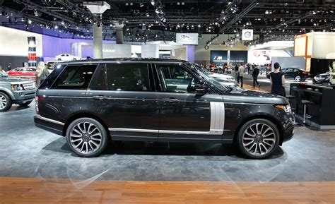 black land rover range rover car and driver