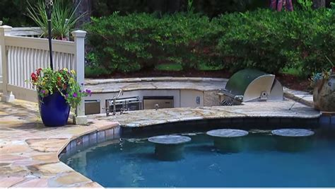 swimming pool and spa with water features and swim up bar aqua blue pools