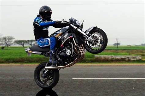 how to wheelie a motocross bike how to do a wheelie on motorbike bicycling and the best