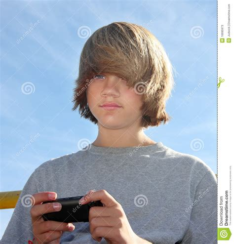cute teen boy stock photos pictures royalty free cute cute teen boy texting stock image image of hair shaggy