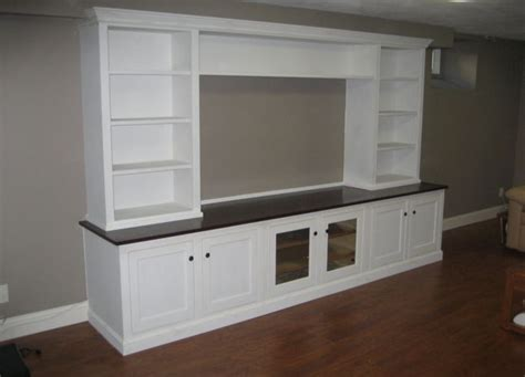 hand crafted built in wall unit for widescreen tv in custom built entertainment center ideas woodworking