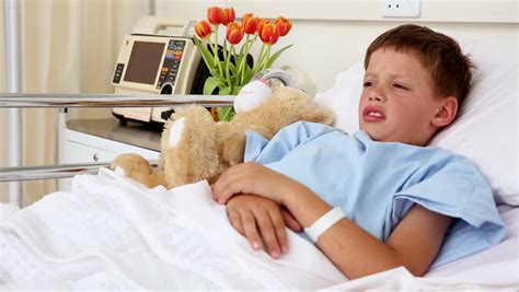 boys in bed little sick boy sleeping in bed with teddy bear in the hospital ward stock footage video 5899901
