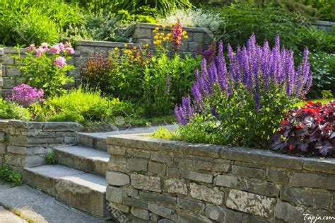 backyard flower ideas flower garden with foreground sedums and stone path in