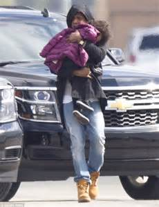 Jay Z carried Blue Ivy to their private jet following