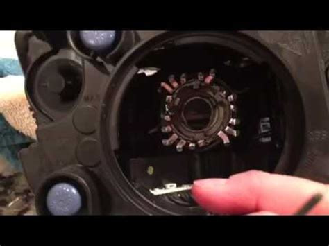 wk jeep hid headlight bulb removal youtube