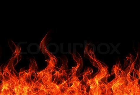 Designer Fireplace - seamless fire and flame border on black background stock photo colourbox