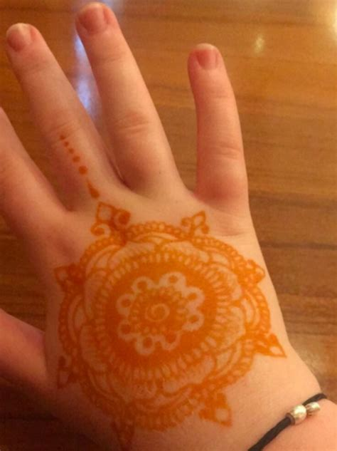 free henna tattoos being offered at restaurant marrakesh