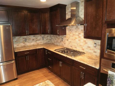 traditional kitchen backsplash traditional kitchen solarius slab and tumbled travertine