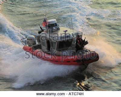 speed boat on hudson river speedboat of us coast guards with machine gun on hudson