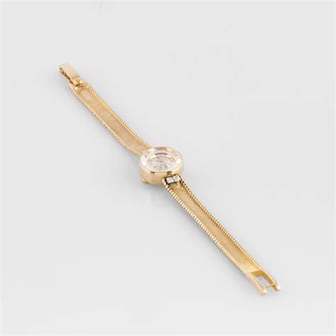 Omega. Bracelet montre de dame en or jaune et diamants   2015060788   Expertissim