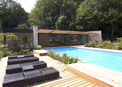 Home Plans For Sloping Lots roundles a modern pool house made of local limestone is a