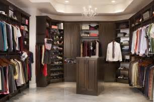Large walk in closet in chocolate pear finish will give you lots of