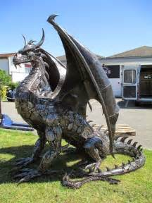 Super cool steampunk looking dragon made from 100 recycled car