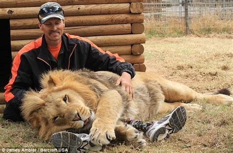 cuddle with a lion helped a thrill seeking double amputee