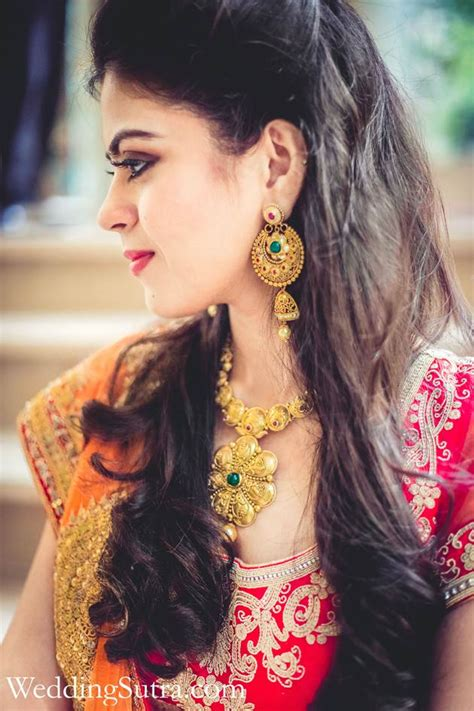 indian hairstyles with lehenga indian bride wearing bridal lehenga and jewelry indian