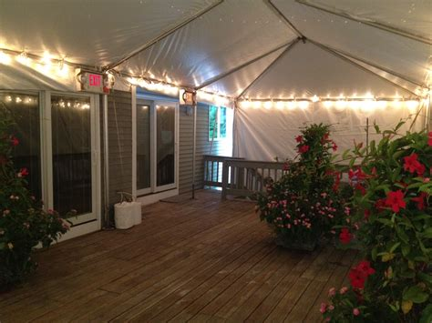 rent a tent for backyard party 15 x 25 frame tent installed on deck with string lighting