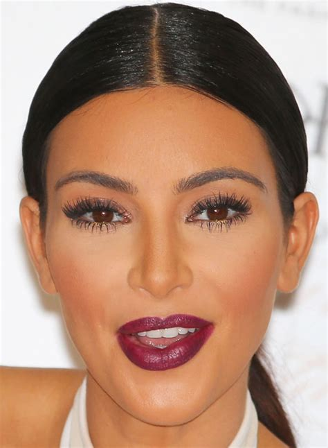 kim kardashians low sleek ponytail with center part celebrity middle part sleek bun sleek buns how to middle and side