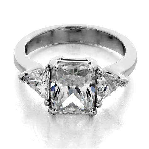 three ring trilliant side stones emerald center
