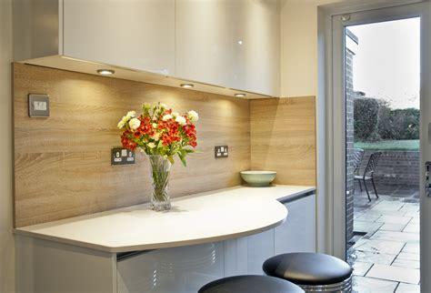 Small Kitchen Design With Breakfast Bar handleless cream kitchen quartz worktops in crawley down