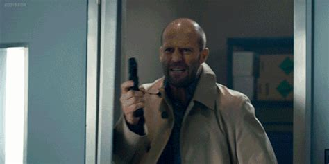 jason statham upcoming film jason statham will fight a dinosaur in the upcoming movie