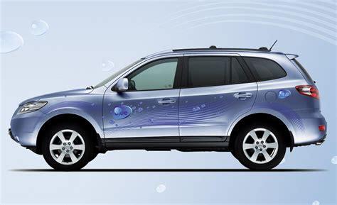 blue santa fe hyundai car and driver