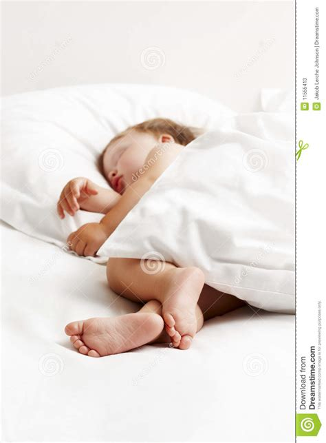 baby sleeping bed baby sleeping in white bed stock photos image 11555413