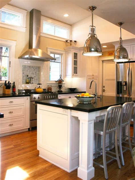 traditional kitchen with prep island and pendant lighting a pair of industrial pendant lights hangs over a white