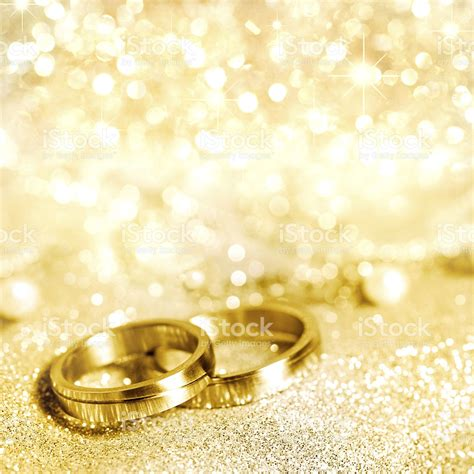 Wedding Rings With Gold by Gold Wedding Rings With Glittering Gold Background Stock