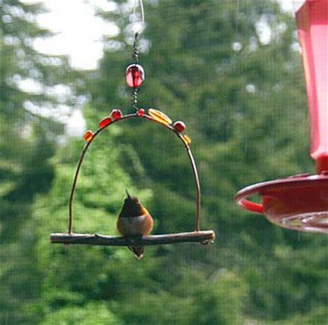 the bird perched on the swing jeweled hummingbird perch on artfire hummingbirds love to