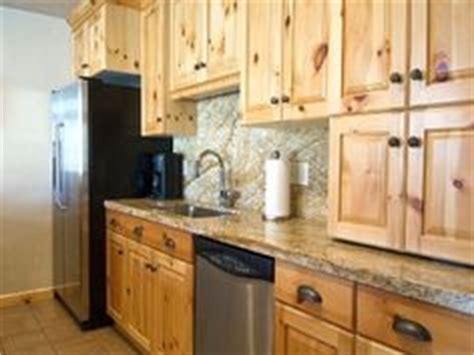 knotty pine cabinets granite counter top traditional furniture traditional kitchen with pine cabinets also