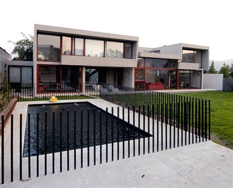 modern backyard fence concrete home architecture decorated with sunlight