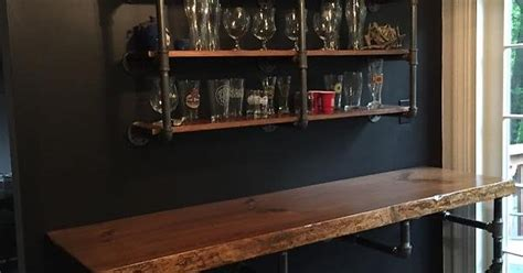 diy black iron pipe bar top and shelves for storage