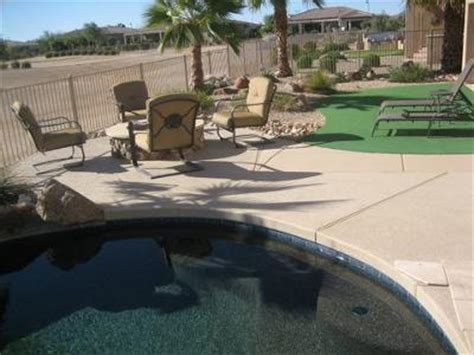 travertine pavers over concrete kool decking around pool