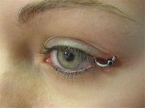 nipple eye tattoo pierced facial piercings