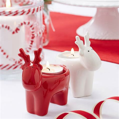 red and white reindeer tea light holder by the christmas