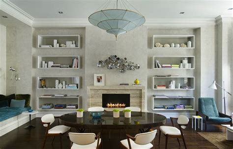 dining table in front of fireplace art in front of bookcases design ideas