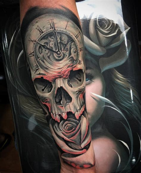 clock skull amp rose fusion on guys arm best tattoo