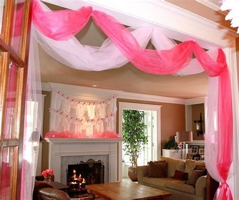 Decorating Ideas With Tulle The Clothesline Of Onesies For Decor And Pink Tulle