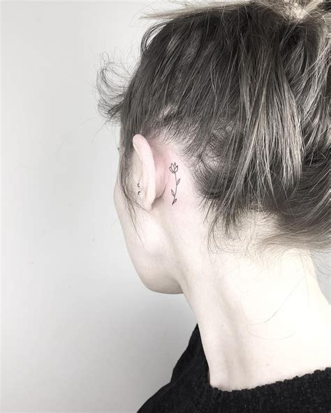 small flower tattoos behind ear the ear flower tattoos on