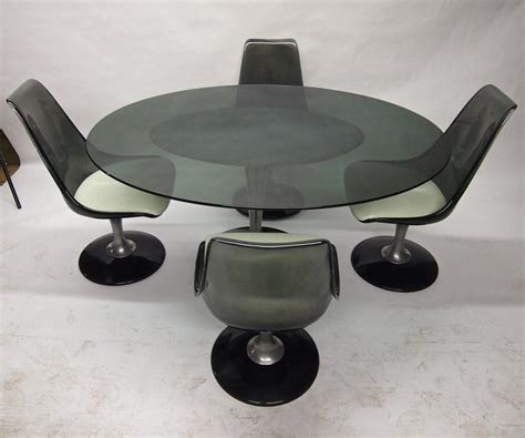 oval dining set with four swivel chairs by chromcraft