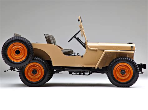 tan jeep profile of willys overland jeep cj 2a shown in