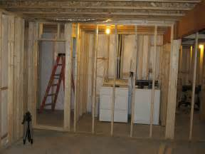 building a room in a basement unfinished basement laundry room beside bathroom for small