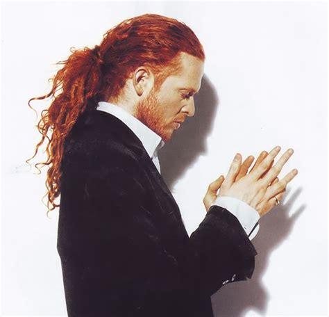 british singer orange hair male red headed english singer songwriter mick hucknall of