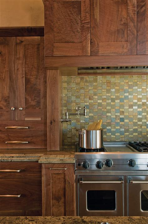 rustic kitchen appliances colorful tiled backsplash with rich cabinets and stainless